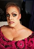 foto of cross-dressing  - Serious drag queen without wig in dressing room - JPG