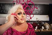 stock photo of drag-queen  - Drag queen in blond and pink grinning - JPG