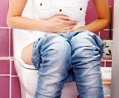 stock photo of peeing  - Woman in the toilet - JPG