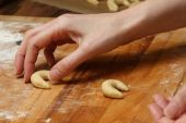 stock photo of doughy  - making some vanilla cornets and knead the doughy - JPG