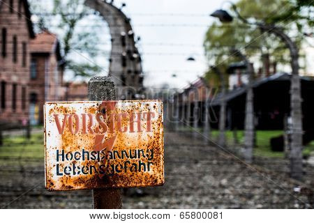 Warning sign in the former concentration and extermination camp Auschwitz-Birkenau in Poland.