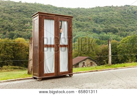 wooden wardrobe abandoned on a mountain road