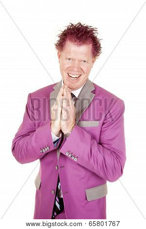 Man In A Purple Suit Hands Together Sly