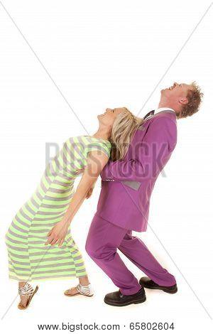 Man Purple Suit Woman Green Dress Lean Back Look Up