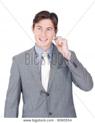 Smiling Young Businessman Using Headset