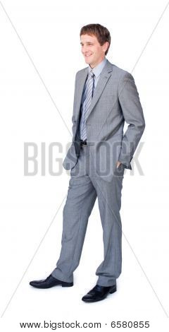 Young Businessman Standing With Hands In Pockets