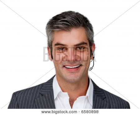Smiling Mature Businessman With Headset On