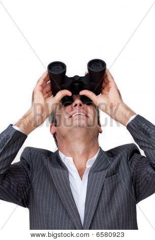 Positive Businessman Looking Up Through A Pair Of Binoculars