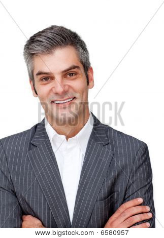 Assertive Mature Businessman With Folded Arms