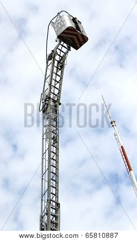 Mobile Platform Completely Extended Upwards With A Ladder Of The Fire Brigade And The Antenna Of Tel