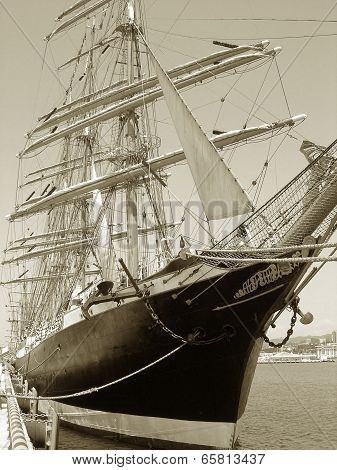 Sail ship in port.