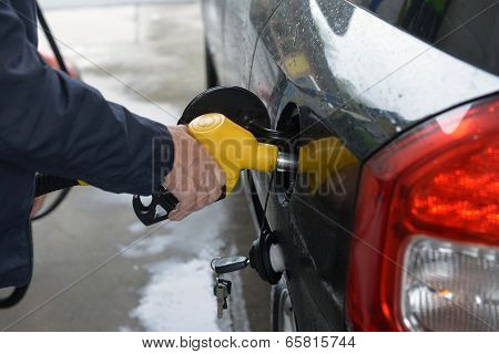 Man Hand Refilling Up Gas Tank