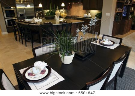 Dining table with kitchen.