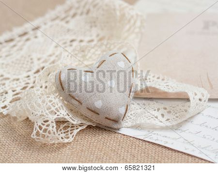 Shabby chic heart on vintage papers