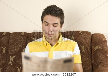 Man Read The News In A Sofa Home