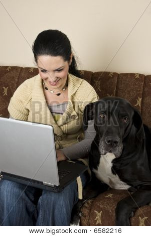 Woman  With Laptop And A Big Dog