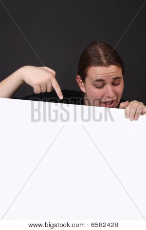 Teen Pointing At Blank Sign