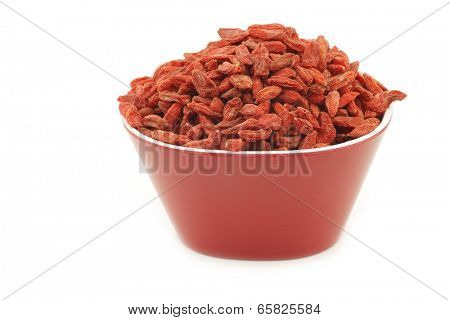 dried goji berries (Lycium Barbarum - Wolfberry) in a red bowl on white background