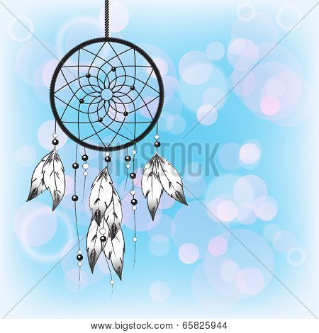 Dreamcatcher silhouetted against a blue sky background with space for your text.