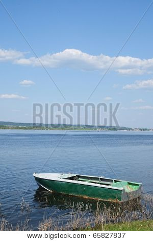 oared boat on a lake bank