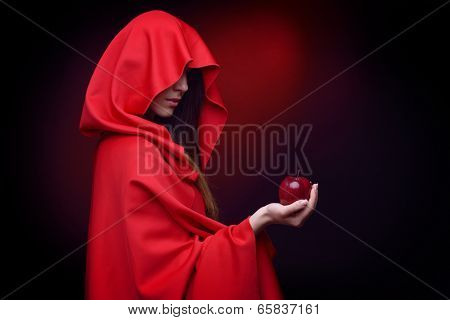 beautiful woman with red cloak holding apple in her hand