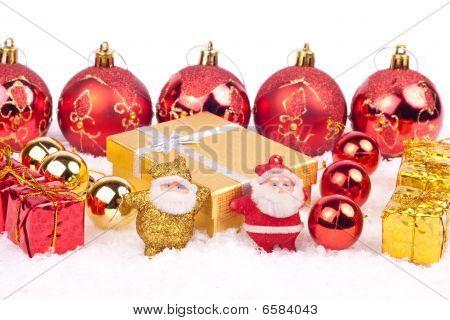 Two Little Santa Toys On Snow