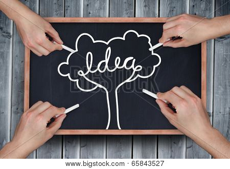 Composite image of multiple hands drawing idea tree with chalk on wooden board