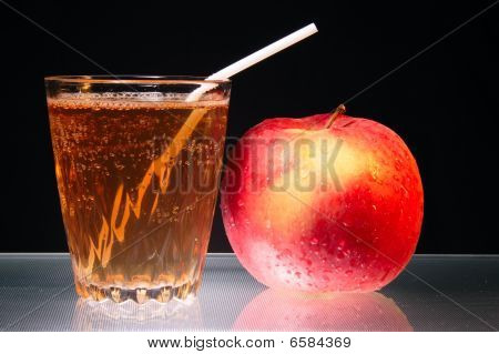Apple And Glass Of Juice On Fluted Glass As Diet Symbol