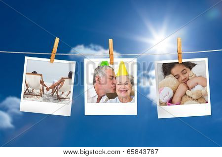 Composite image of instant photos hanging on a line against sunny blue sky
