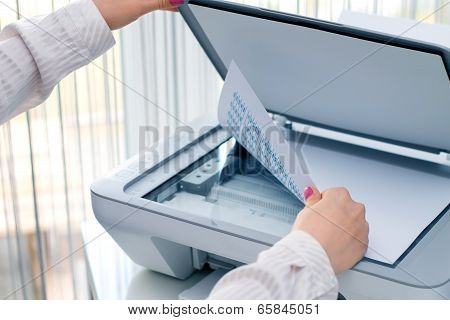 Woman scan documents at work
