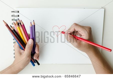 Man sketching in a sketch book