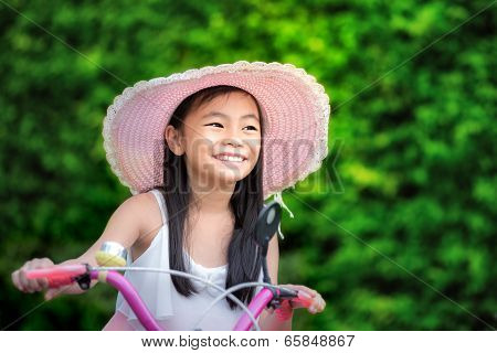 Asian Little Girl With Her Bicycle