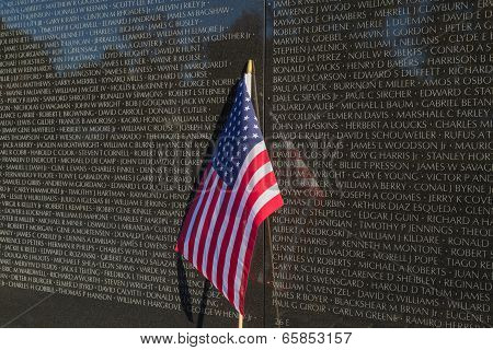 Washington, DC - US flag leaning on Vietnam Memorial Wall