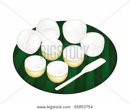 Thai Dessert Of Coconut Pudding On Banana Leaf