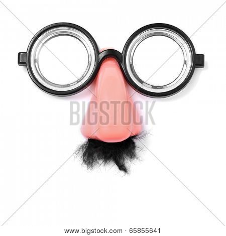 fake short-sighted glasses, nose and moustache forming a face on a white background