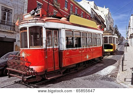 view of two typical old trams in Lisbon, Portugal