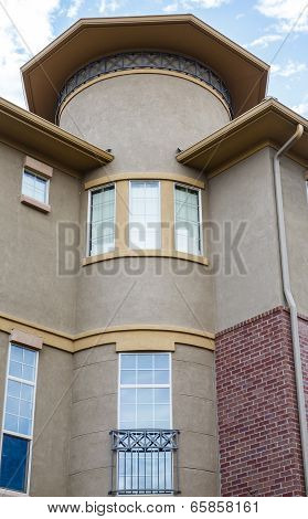 Windows On Modern Stucco Condo Building