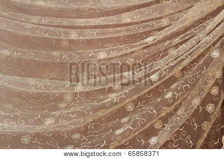 The Tulle Which Has Been Beautifully Draped In The Form Of Folds (the Background Image).