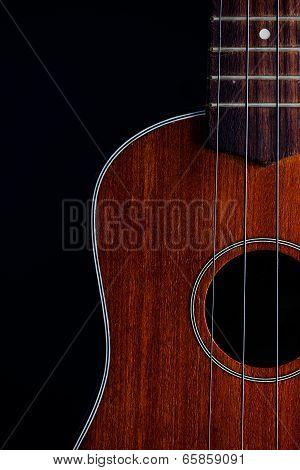 Ukulele Hawaiian Guitar Over Dark Background.