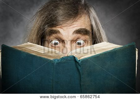 Senior Reading Open Book, Surprised Old Man, Amazing Eyes Looking Blank Cover