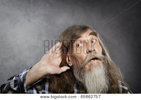 Senior Man Tries To Listen Sound. Elder Hearing Loss Deafness.