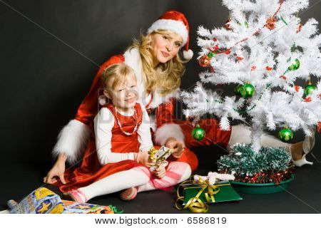 santa girl playing with little girl