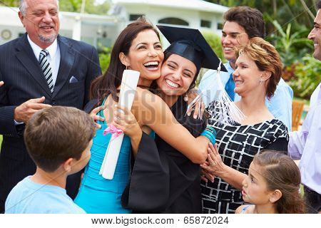 Hispanic Student And Family Celebrating Graduation