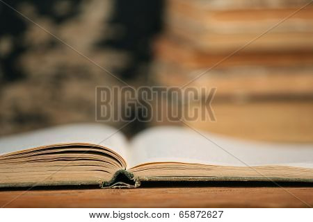 Open End Of The Old Book On A Wooden Boards
