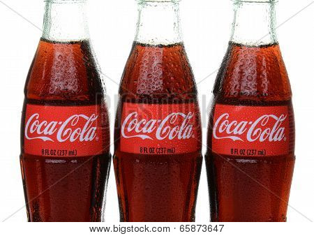Three Bottles Of Coca-cola