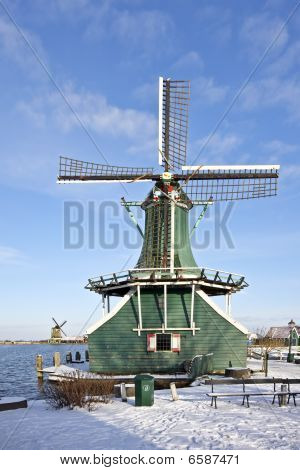 Old traditional dutch windmill in the Netherlands in wintertime