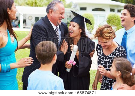 Hispanic Student And Family Celebrating Graduation