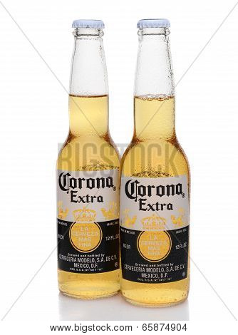 Two Corona Extra Bottles With Condensation