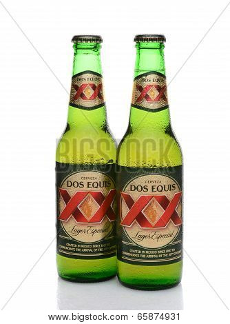 Two Dos Equis Bottles With Condensation