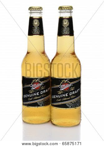 Two Miller Genuine Draft Bottles With Condensation